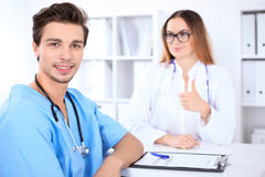 Attractive male surgeon doctor in hospital. Medicine and health care concept Stock Images