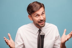 Attractive male tv reporter is working at studio Stock Image