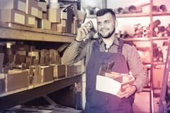 Attractive male worker sorting sanitary engineering details Royalty Free Stock Photography