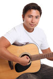 Attractive man with an acoustic guitar Stock Image