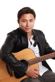 Attractive man with an acoustic guitar Royalty Free Stock Photo