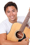 Attractive man with an acoustic guitar Royalty Free Stock Photos