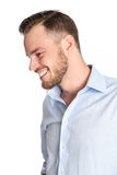 Attractive man against white background. Attractive man standing with a white white background wearing a blue shirt, feeling great Stock Image