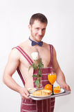 Attractive man in an apron with breakfast Royalty Free Stock Photo