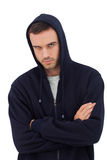 Attractive man with arms crossed looking angry Royalty Free Stock Image