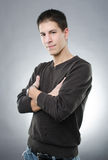 Attractive man with arms folded Royalty Free Stock Photo