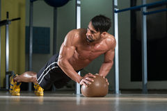 Attractive Man Athlete Performing Push-Ups On Medicine Ball Royalty Free Stock Photos