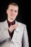 Attractive man with banknotes in his pocket Stock Image