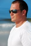 Attractive man at beach stock photos