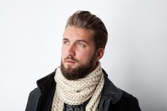 Attractive man with a beard and a scarf. Isolated on a white background royalty free stock photography