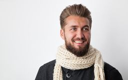 Attractive man with a beard and a scarf. Isolated on a white background stock photo