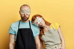 Attractive man and beautiful ginger woman in an apron and night stock photos