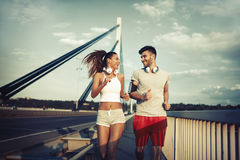 Attractive man and beautiful woman jogging together Royalty Free Stock Image