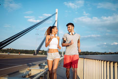 Attractive man and beautiful woman jogging together Stock Photos