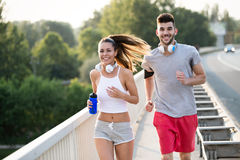 Attractive man and beautiful woman jogging together Royalty Free Stock Photography