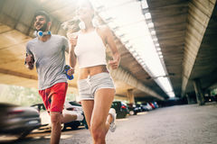 Attractive man and beautiful woman jogging together Stock Image