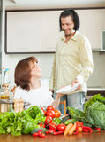 An attractive man and beautiful woman with vegetables in the kit Stock Photography