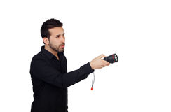 Attractive men in black with a flashlight looking for something Royalty Free Stock Image