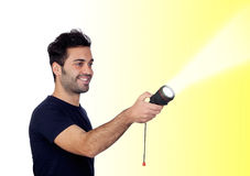 Attractive men in black with a flashlight looking for something Royalty Free Stock Images