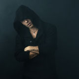 Attractive man in  black hoodie crossed his arms Stock Photo