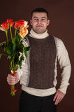 Attractive man with a bouquet Royalty Free Stock Photo