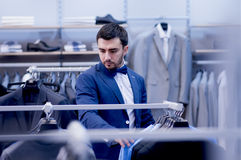 Attractive man in boutique of clothing. Handsome man in boutique of clothing Royalty Free Stock Images