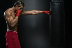 Attractive Man With Boxing Bag Stock Photography
