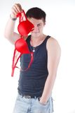 Attractive man with bra Stock Images