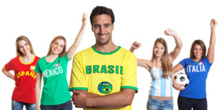 Attractive man from Brazil with four female sports fans Royalty Free Stock Images