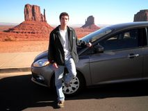 Attractive Man Car Landscape. Sucessful young man with car in Arizona landscape stock photo