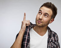 Attractive man in casual clothes - close up portrait on gray background. Royalty Free Stock Photography