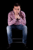 Attractive man on chair Royalty Free Stock Photo