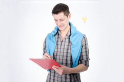 Attractive man checks the task. Interviews and work study. Attractive man on a white background Stock Image
