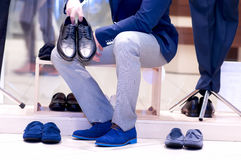 Attractive man chooses a shoes. Royalty Free Stock Image