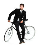 Attractive man in a classic suit with a bicycle on a white Stock Photography