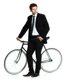 Attractive man in a classic suit with a bicycle on a white Royalty Free Stock Photography