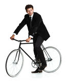 Attractive man in a classic suit with a bicycle on a white Royalty Free Stock Images