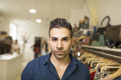 Attractive man in clotes store Royalty Free Stock Photography