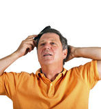 Attractive man combing his hair Royalty Free Stock Photo
