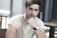 Attractive man  in contemplation. Attractive man deep in contemplation Stock Images