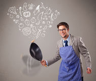 Attractive man cooking vegetables Royalty Free Stock Image