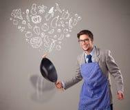 Attractive man cooking vegetables. Attractive young man cooking vegetables Royalty Free Stock Image