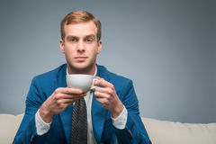 Attractive man with cup of tea Royalty Free Stock Image