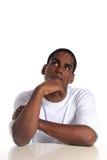 Attractive man deliberates a decision Stock Image