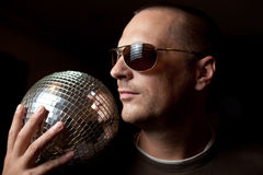 Attractive man with disco ball Stock Images