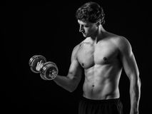 Attractive man doing bicep curls Stock Images