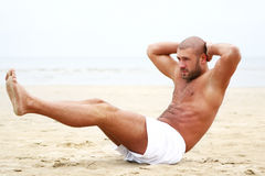 Attractive man doing fitness workout Royalty Free Stock Photography