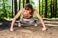 Attractive man doing a push up Royalty Free Stock Image