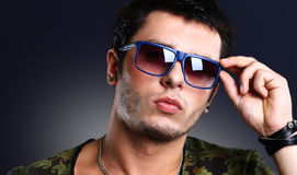 Attractive man dressed casual wearing glasses Royalty Free Stock Photo