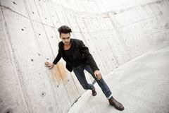 Attractive man dressed in jeans and boots Royalty Free Stock Images